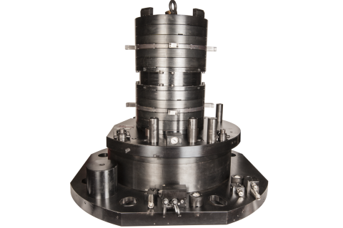 Industry:  Transportation  <br/>Part Type:  Magnet Frame <br/> Machining Center:  Vertical Turning/Milling Center  <br/>This OP10 fixture uses two custom 2+2 chucks to locate and clamp a large weldment.